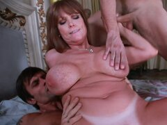 Busty Darla Crane handles two young boys in her bedroom