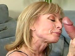 Mature lady Nina Hartley dresses up hot for him