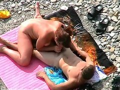 Voyeur clip of couple fucking on beach