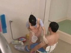 Horny Teen Nurse Gets A Patient Off During His Bath