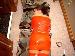 Weird Woman Wrapped In Orange Tape Asleep