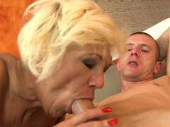 Blonde granny Orhidea sucks and rides a cock in a sauna