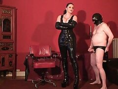 Tall chick in latex dominates her man