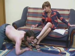 Leashed slave boy kisses her feet