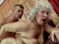 Lewd granny Norma fucks some guy and lets him cum on her boobs