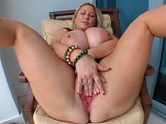 Fat blonde with giant tits masturbates pussy
