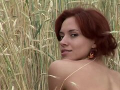 Redhead in field with natural tits